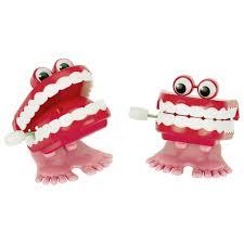 Шуточная заводная игрушка Зубы GOKI